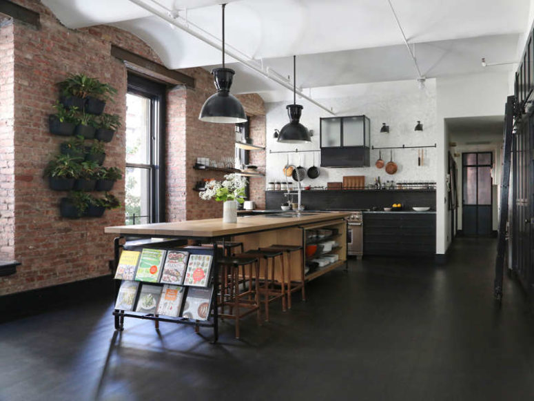 industrial loft with exposed brick walls and black wood digsdigs. Black Bedroom Furniture Sets. Home Design Ideas