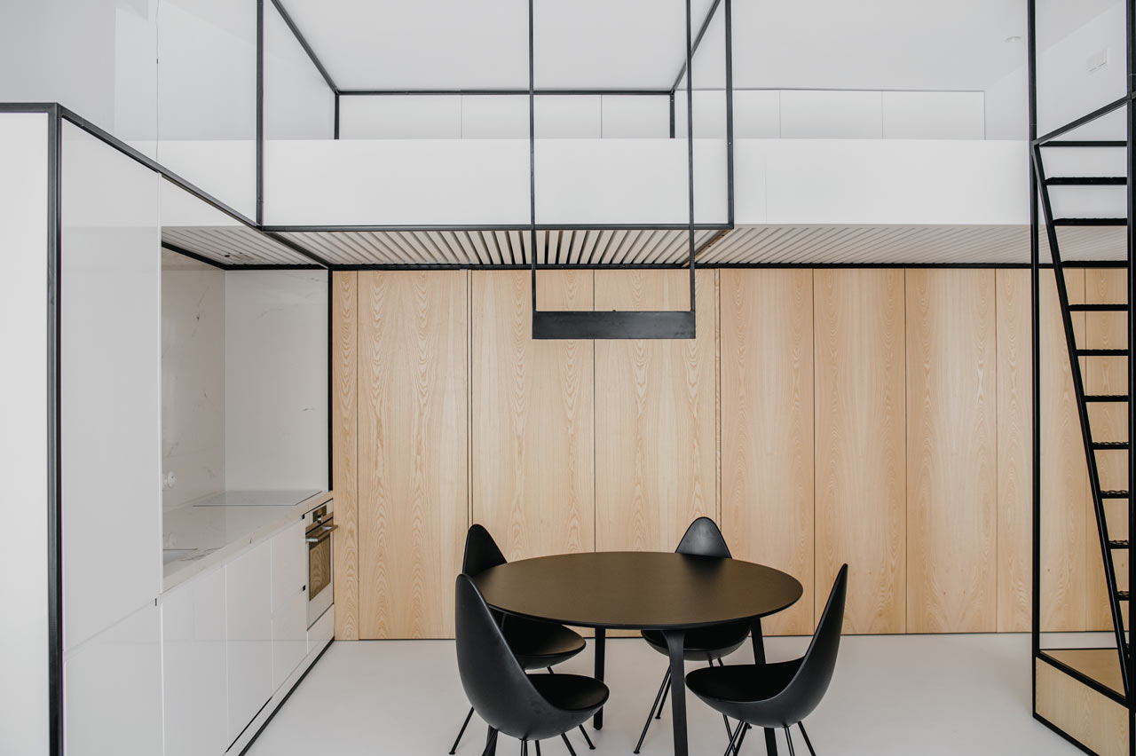 This modern apartment with a minimalist color palette features black framing, which adds functionality and ties up the decor