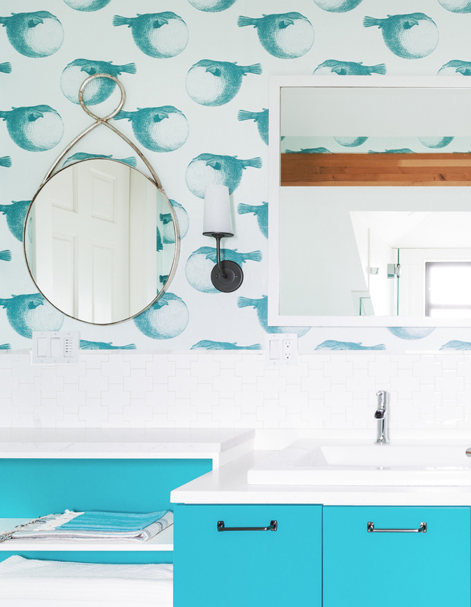 The blowfish wall covering sets the tone in this cheerful space