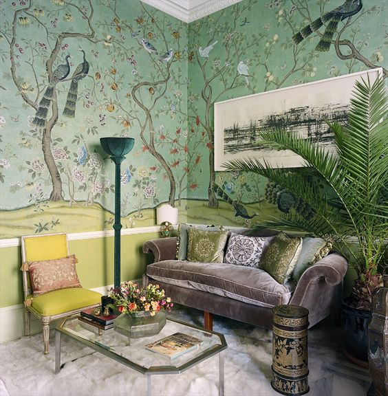 The living room features unique silk wallpaper, velvet furniture and soft textiles