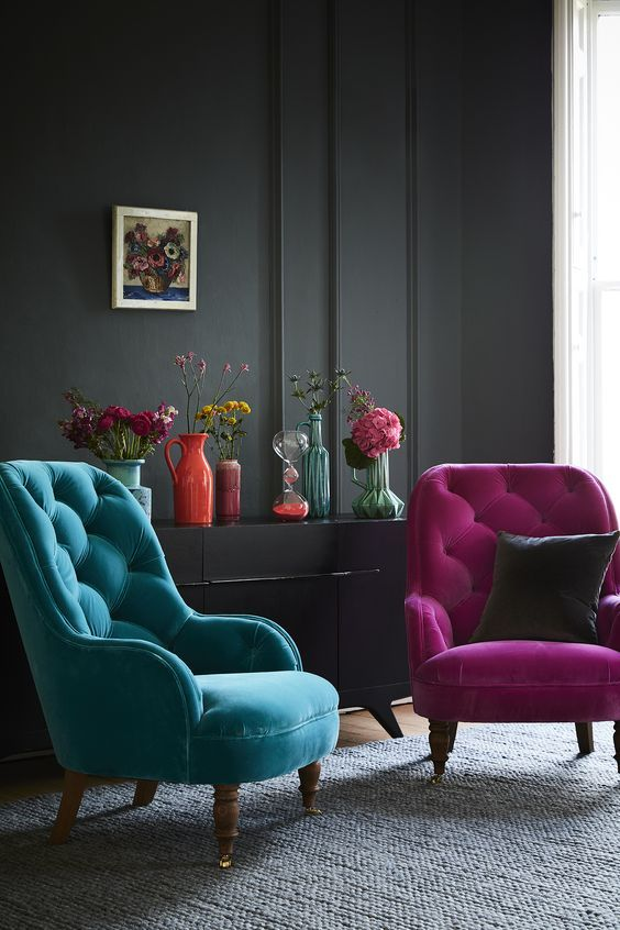 A Moody Interior Is Made Cheerful With A Fuchsia And A Turquoise Chair And  Colorful Vases