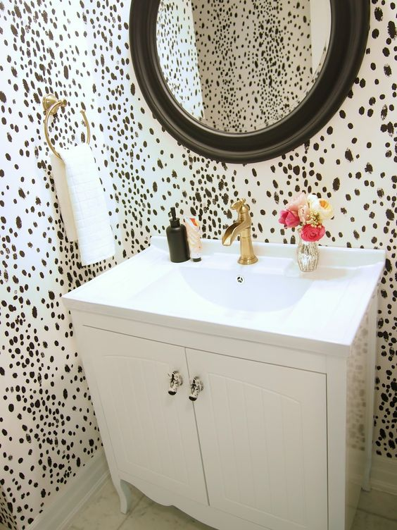 dalmatian print wallpaper to make a powder room more eye catching and glam