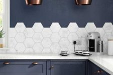 02 marble hexagon tiles and countertops stand out in this navy grey kithcne with copper accents