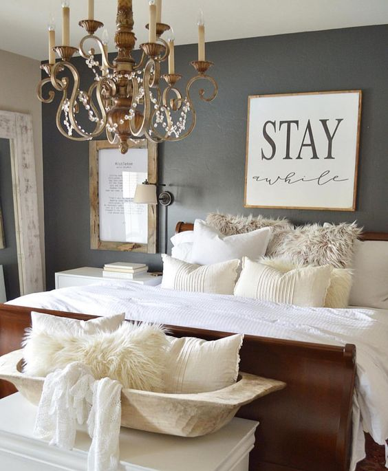 This Guest Bedroom Features A Vintage Chandelier And Wall Sconce For Reading In Bed
