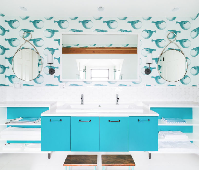 The bathrooms features a turquoise vanity with four compartments, open shelving on both sides and a large mirror