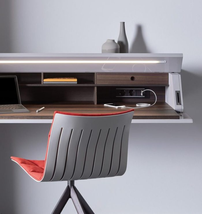 The desk has additional lighting and outlets for various devices you may use