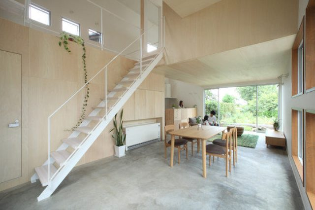 The dining space features a light-colored modern dining set, and there's a ladder going up to the next levels