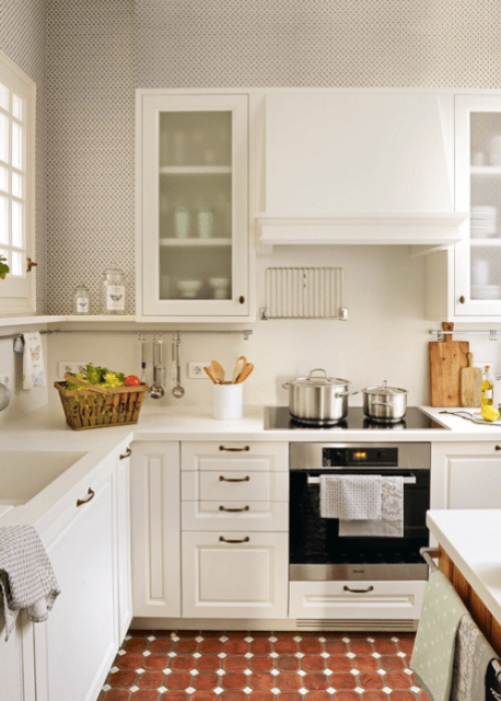 The kitchen features white cabinets and surfaces