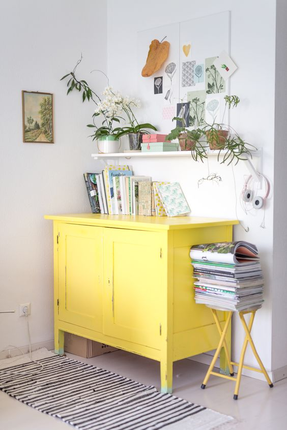 a neutral interior will play out in new shades with a sunny yellow sideboard and a stool