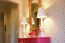03 glam dalmatian print statement wall for a bold hallway and a hit pink console to nail it