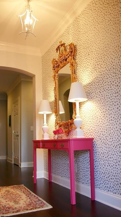 glam dalmatian print statement wall for a bold hallway and a hit pink console to nail it