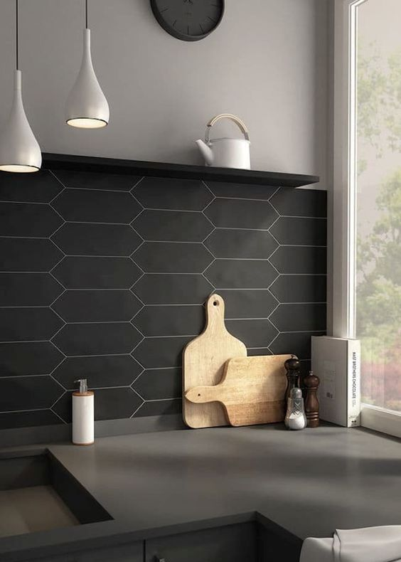 matte black tile kitchen backsplash and concrete countertops for a chic masculine kitchen