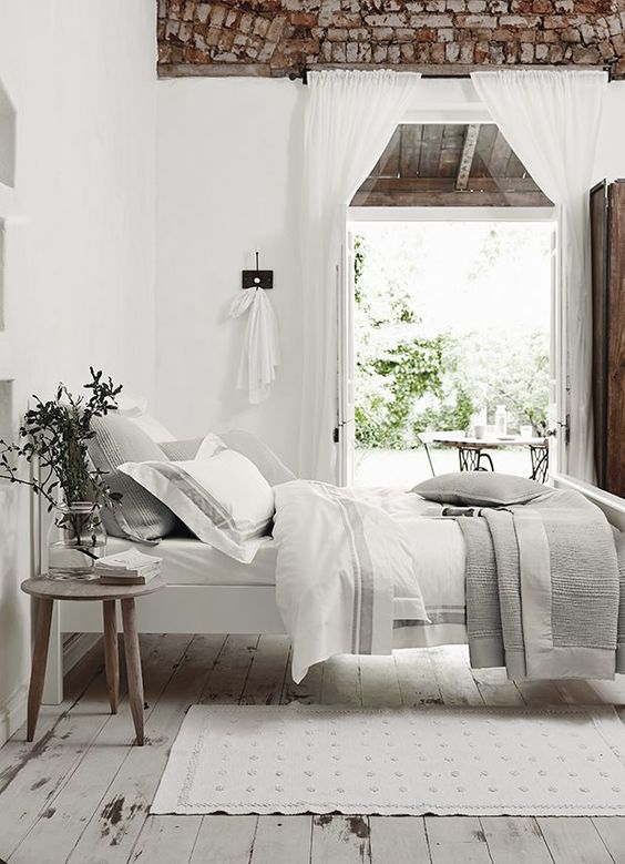 rough brick on the ceiling, white walls and whitewashed wooden floors, greys and white