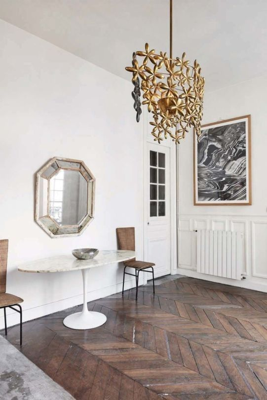 The home is filled with interesting items like this floral chandelier, a vintage mirror and many artworks