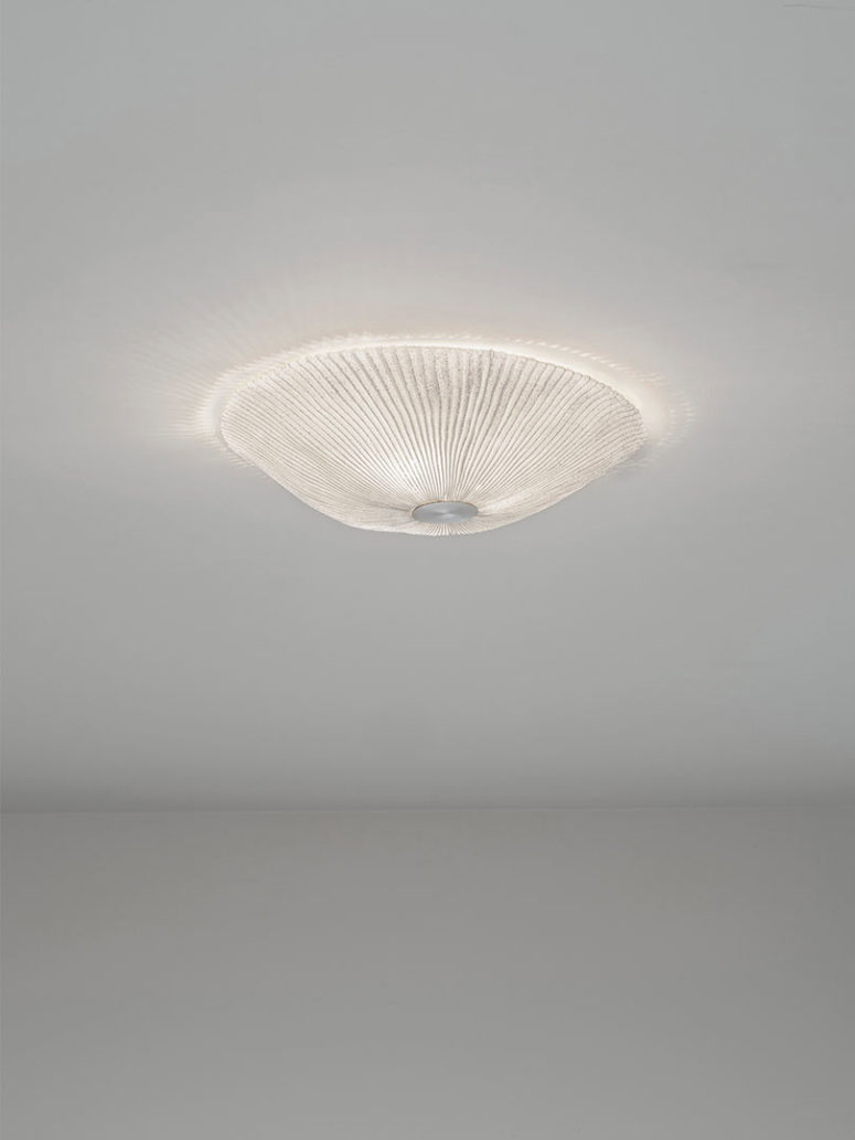 This is a ceiling lamp looking like a glowing shell or jelly fish