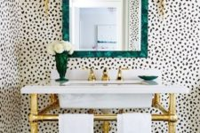 04 a glam powder room with dalmatian print wallpaper and brass accents