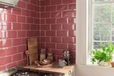 04 glossy pink tiles make up a cool backsplash for a girlish kitchen