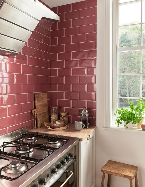 glossy pink tiles make up a cool backsplash for a girlish kitchen