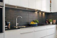 04 matte black rectangular tiles add texture to the kitchen decor