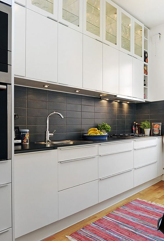 matte black rectangular tiles add texture to the kitchen decor
