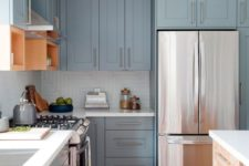 04 pale blue vintage kitchen with metallic handles and white countertops