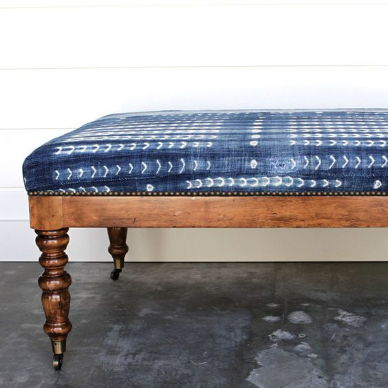 renovate an old bench adding casters and reupholstering it with shibori fabric to give it a cool look