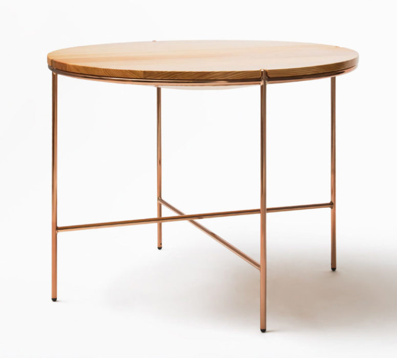 A round table will fit any modern space, and chic copper touches are right what you need