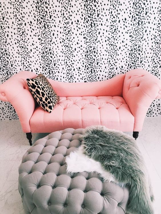 a glam girlish space with a dalmatian print wall, it looks cool and chic