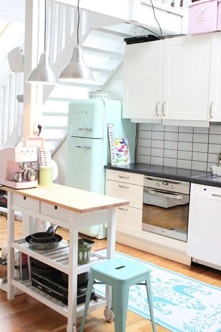 a mint Smeg fridge and a matching stool for a small and cozy neutral kitchen