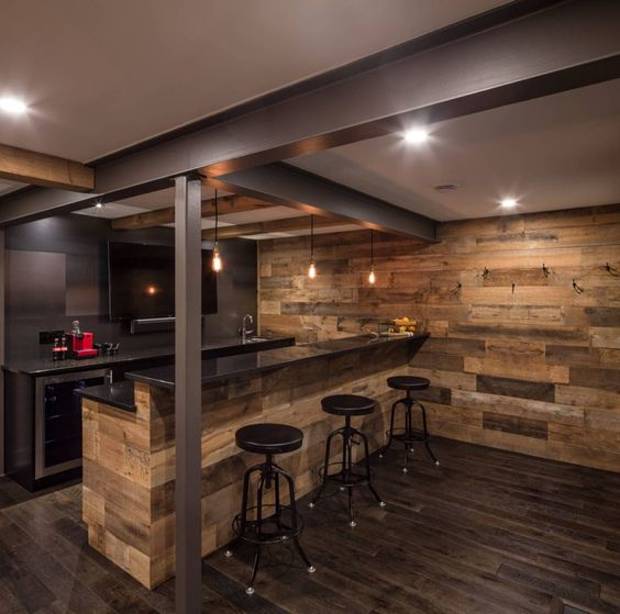 a rustic and modern space with lots of wood and metal surfaces, bulbs for lights