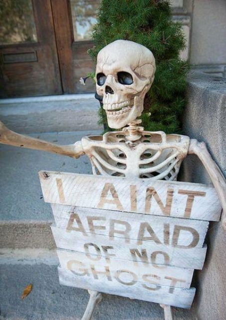 a skeleton with a proper fun sign will be a nice decoration for your porch