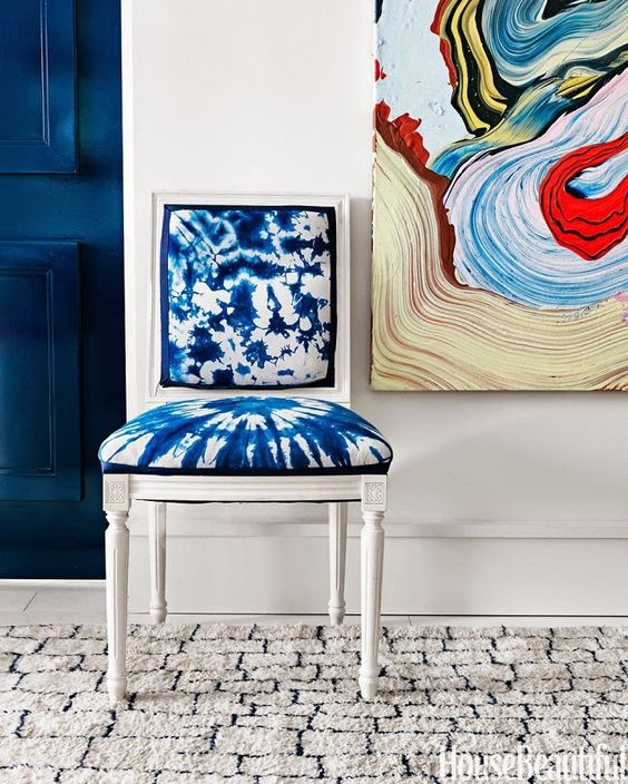 a vintage white chair is spruced up with shibori fabric and made cooler
