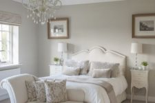 05 a white glam chandelier and traditional lamps for the bedside