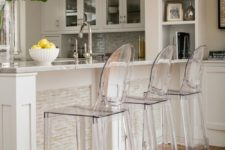 05 accantuate a bar counter with gorgeous sheer acrylic chairs for a modern twist