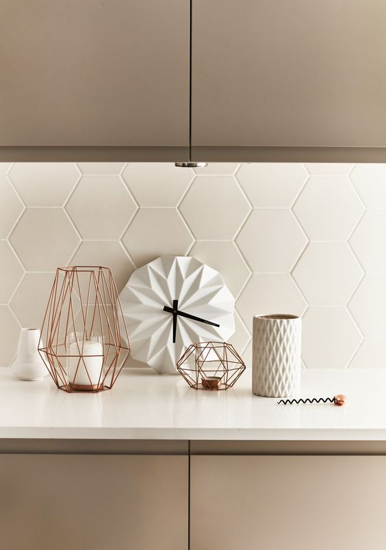 matte white tiles with white grout make up a gorgeous textural backsplash