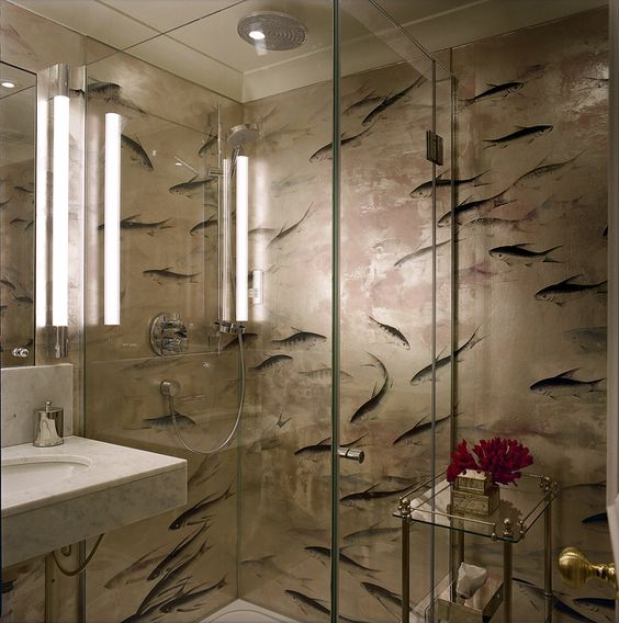 In the bathroom the fish print wallpaper is treated to resist moisture