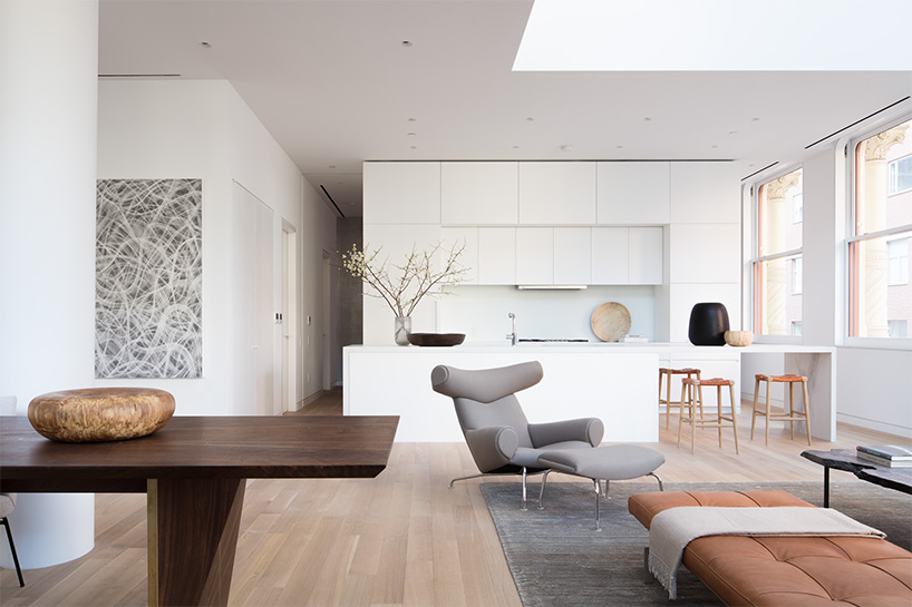 The furniture is a mix of vintage and custom made furniture, the mix looks unique and bold artworks add style to the space