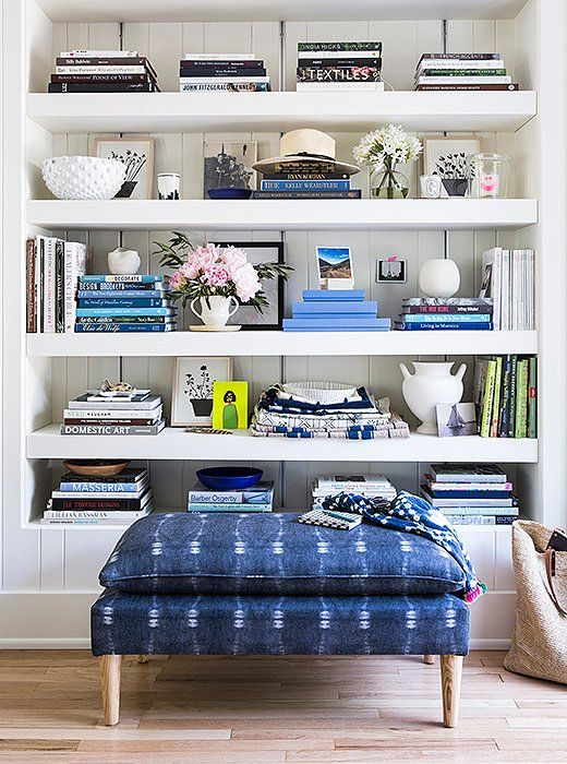 a shibori upholstered ottoman will bring a proper feel to a coastal house