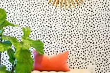 06 dalmatian print wallpaper makes this entryway eye-catchy and brass accents add glam