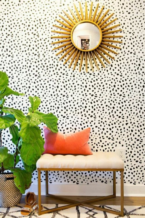 dalmatian print wallpaper makes this entryway eye-catchy and brass accents add glam
