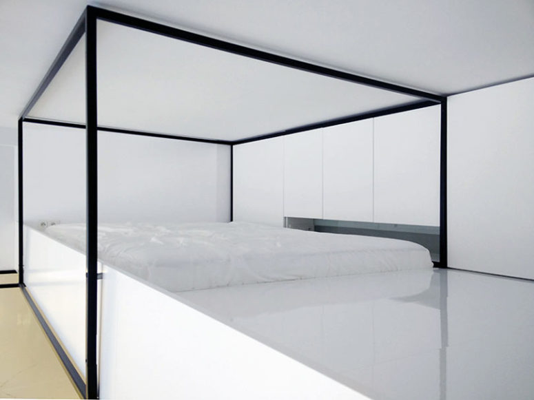 The bedroom features a platform, which acts as a bed and some cabinets - who needs more for comfortable sleep