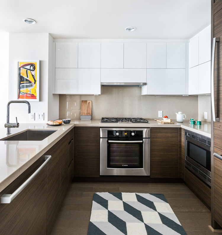 The kitchen is done half white and half natural to make it look more airy