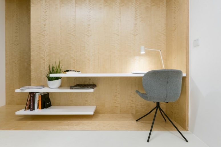 The workspace is made up of three floating shelves, one of which is a desk, the other two are shelves for storage