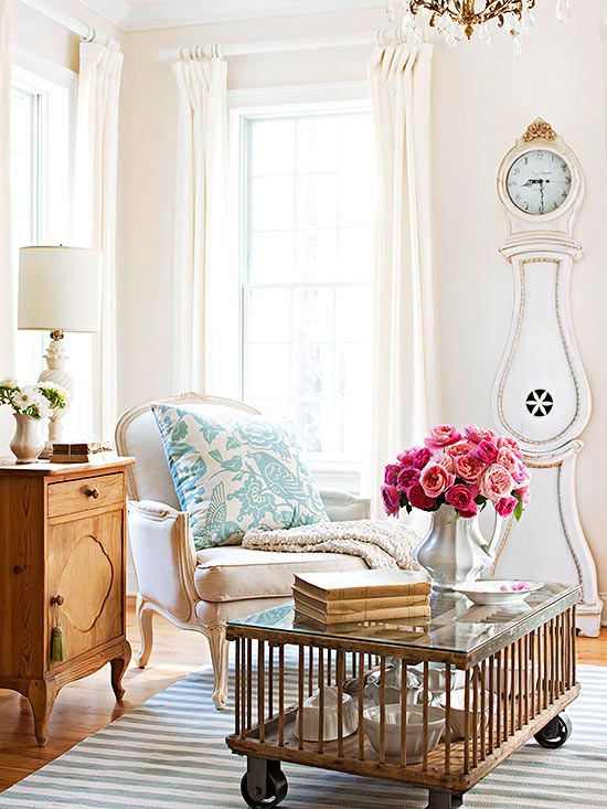 a chic living room with a refined flavor and a gorgeous white and gold grandfather's clock