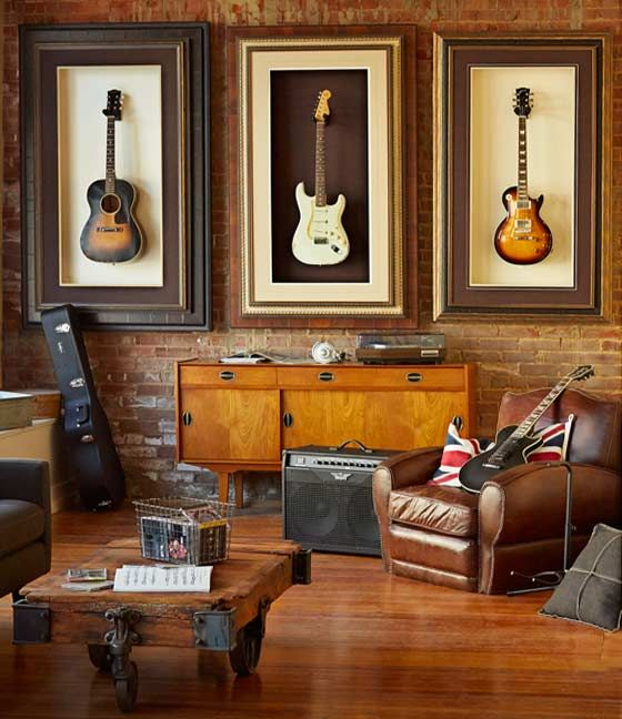 a chic modern space with an industrial feel, guitars displayed on the wall and leather furniture