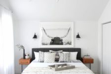 07 a modern black chandelier and small black sconces for a stylish modern bedroom