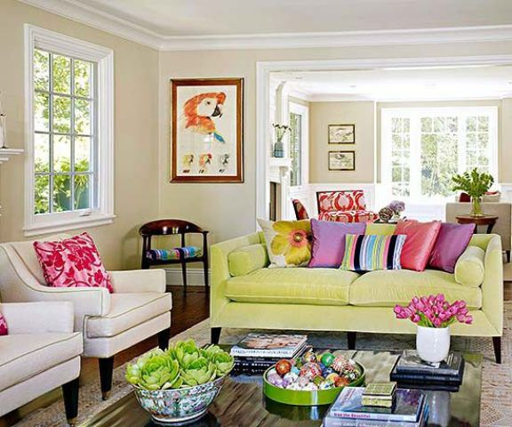 a neon yellow sofa adds color to this neutral living room and so do colorful pillows