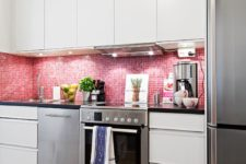 07 a neutral kitchen was turned into a feminine space with glossy pink tiles on the backsplash