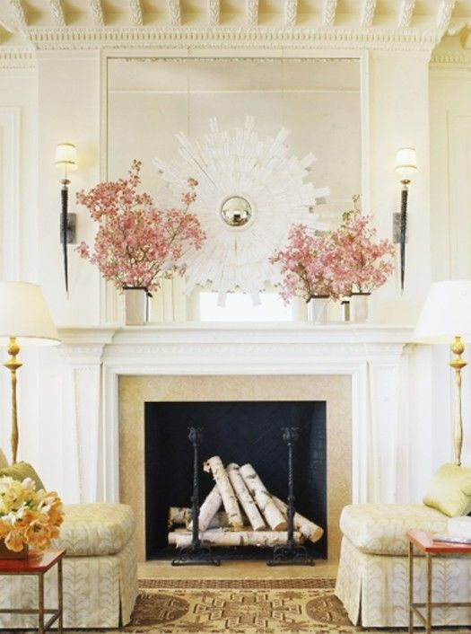place some firewood and stands inside to imitate readiness to use the fireplace