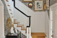 07 zebra print wallpaper for a glam and refined entryway and a warm-colored stair runner